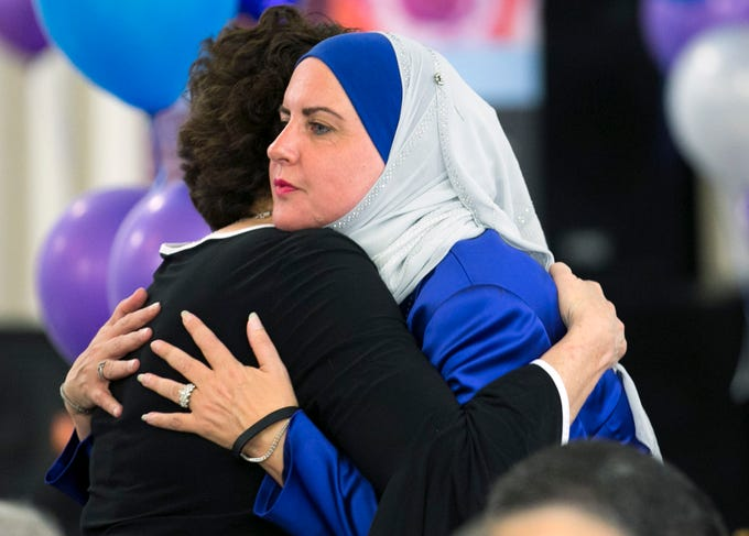 Deedra Abboud, who is vying for the Democratic nomination for the U.S. Senate seat, hugs a supporter at a watch party for the Arizona primary at Pearls Banquet Hall in Mesa on Tuesday evening, August 28, 2018.