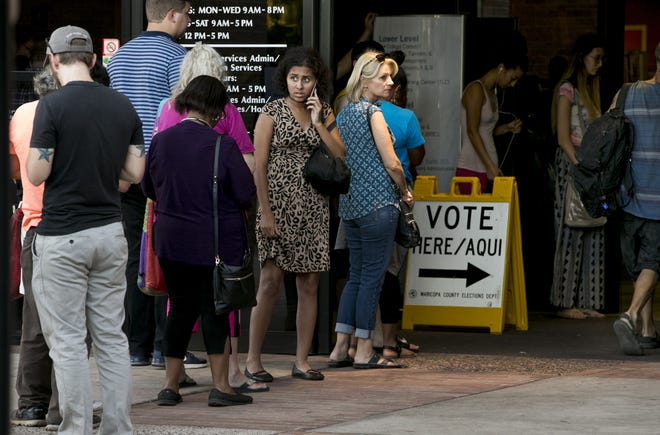 People wait in line to vote at the Tempe Public Library on Aug. 28, 2018. People leaving the polling place said they waited in line for an hour.