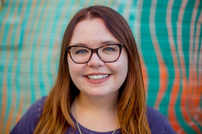 Amanda Luberto, of Phoenix, poses for a portrait outside of GenuWine in downtown Phoenix.