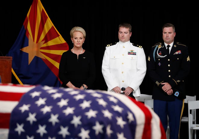 Cindy McCain, wife of Sen. John McCain, R-Ariz. stands with her sons Jack and Jimmy, right, during a memorial service at the Arizona Capitol on Wednesday, Aug. 29, 2018, in Phoenix. (AP Photo/Jae C. Hong, Pool)