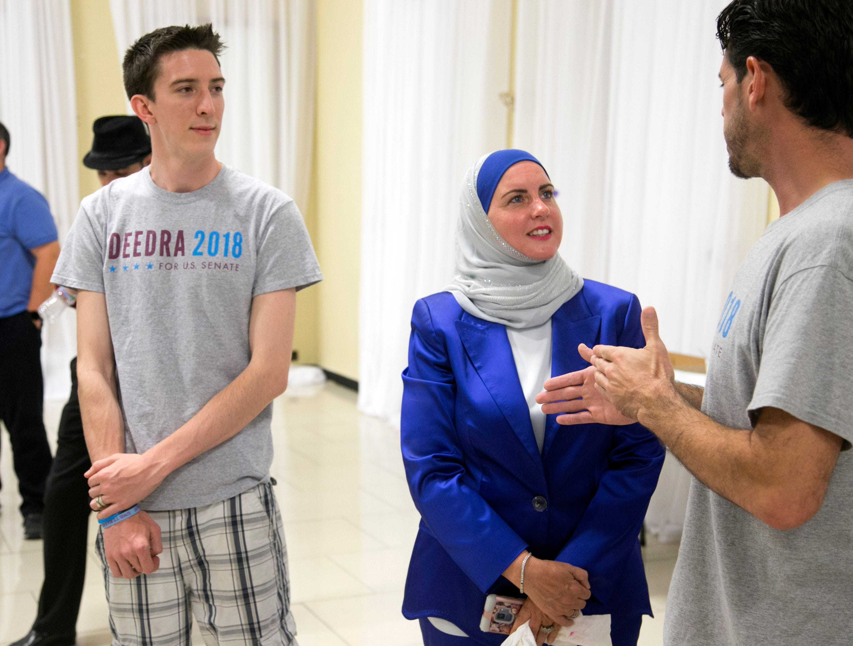 Deedra Abboud, who is vying for the Democratic nomination for the U.S. Senate seat, talks with John O'Neal (right) and Dane Amling, both volunteers from her campaign, at a watch party for the Arizona primary at Pearls Banquet Hall in Mesa on Tuesday evening, August 28, 2018.