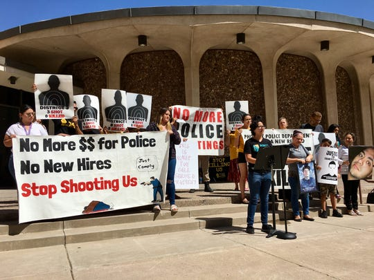Demonstrators gather Wednesday, Aug. 29, 2018, outside Phoenix City Council Chambers to bring attention to the number of police shootings in Phoenix this year.