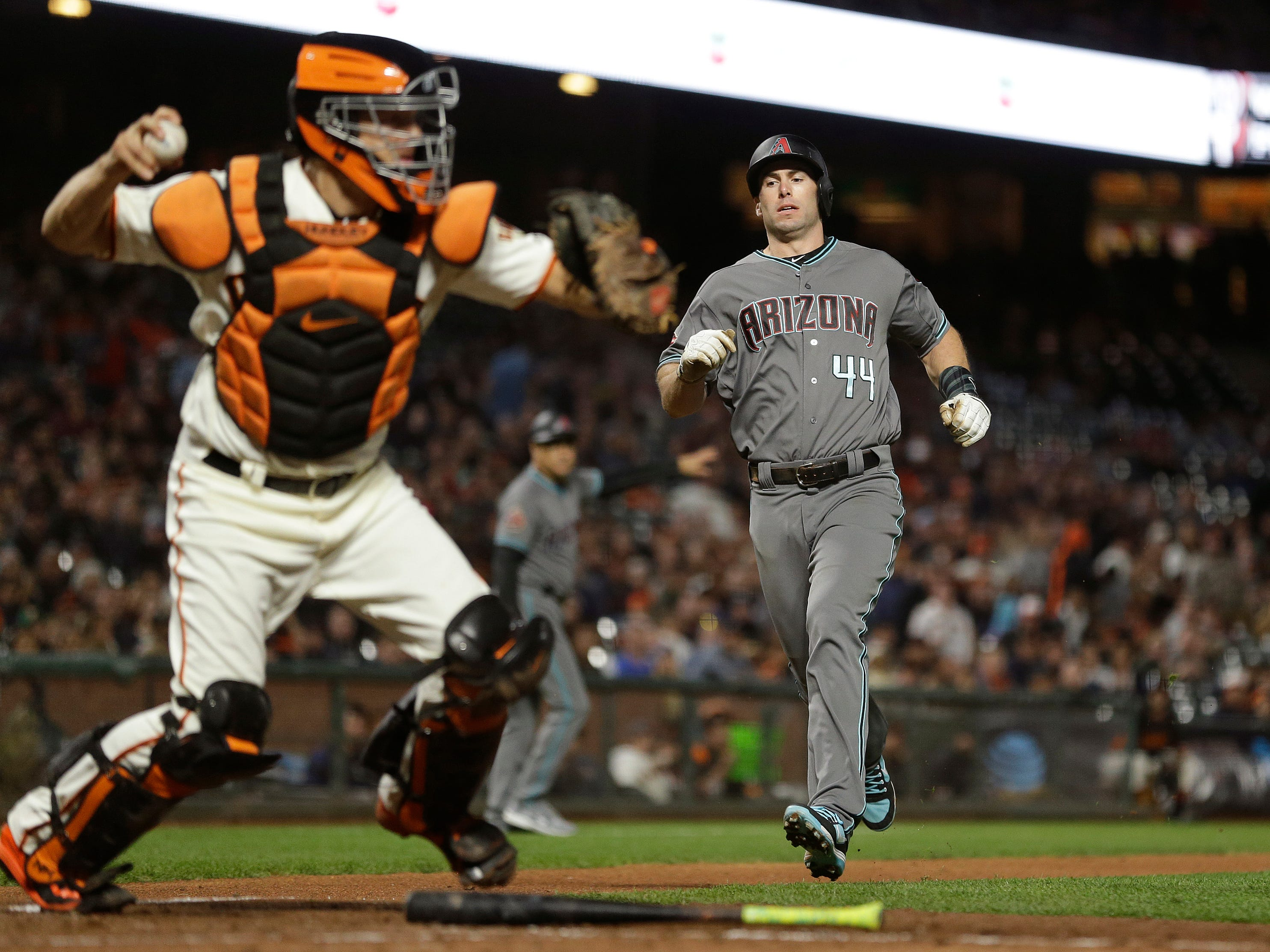 Arizona Diamondbacks' Paul Goldschmidt, right, is forced out at home plate on a fielder's choice as San Francisco Giants catcher Nick Hundley throws the ball to first base in the sixth inning of a baseball game, Tuesday, Aug. 28, 2018, in San Francisco. The Diamondbacks' Ketel Marte was safe at first base on the play.