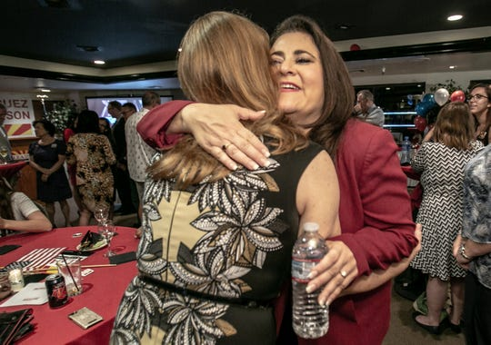 Lea Marquez Peterson, Republican candidate for the 2nd Congressional District seat, hugs well-wisher Heather Floyd, president of the Benson Chamber of Commerce, as she welcomes the crowd during her watch party at Viscount Suite Hotel on Aug. 28, 2018, in Tucson.