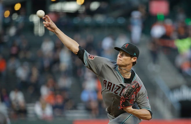 Arizona Diamondbacks starting pitcher Clay Buchholz works in the first inning of a baseball game against the San Francisco Giants, Tuesday, Aug. 28, 2018, in San Francisco.