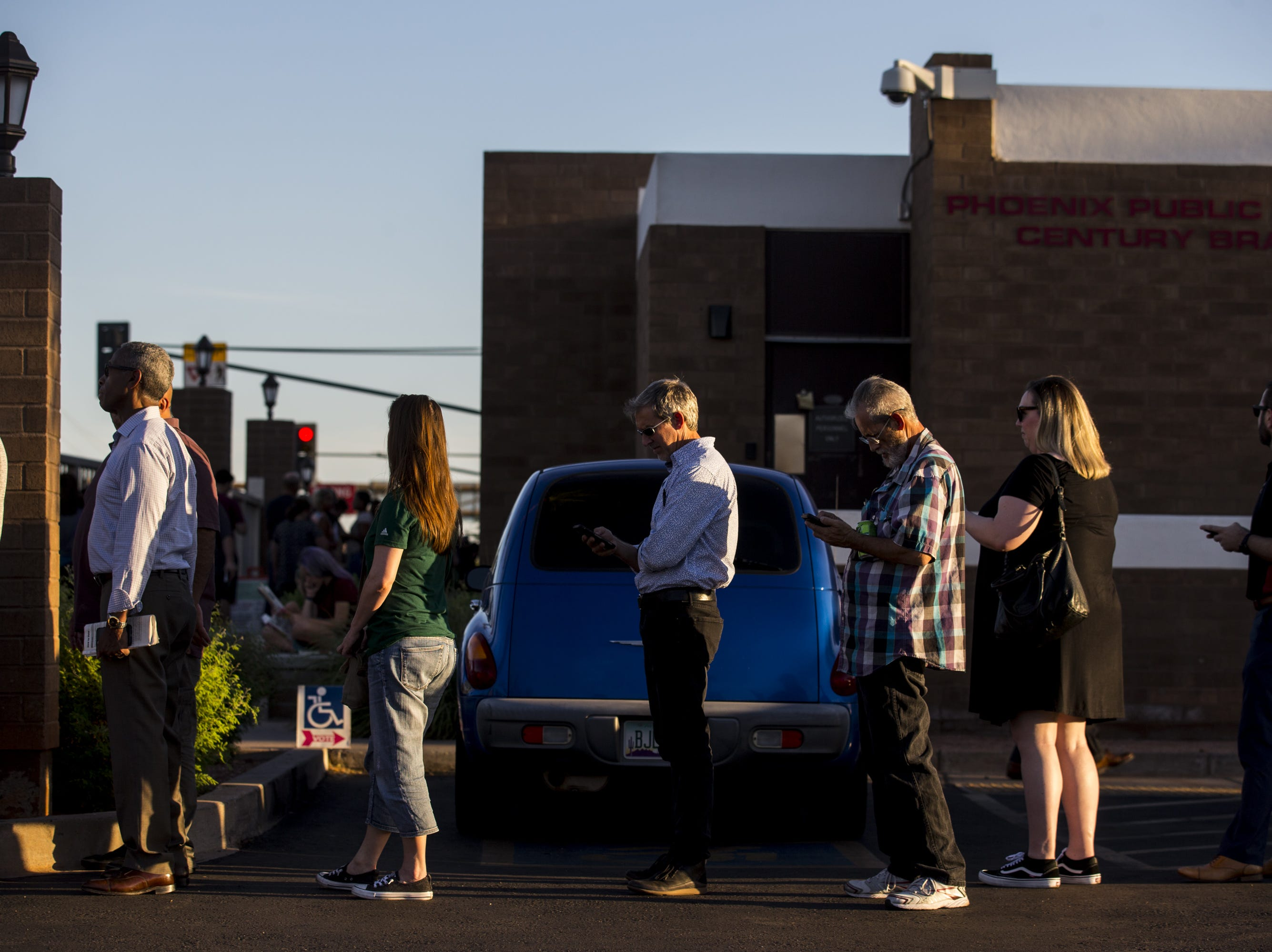 People wait in line to vote on Aug. 28, 2018, at the Phoenix Public Library Century Branch in Phoenix.