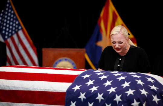 Meghan McCain, daughter of Sen. John McCain, R-Ariz., cries at the casket of her father during a memorial service at the Arizona Capitol on Aug. 29, 2018, in Phoenix.