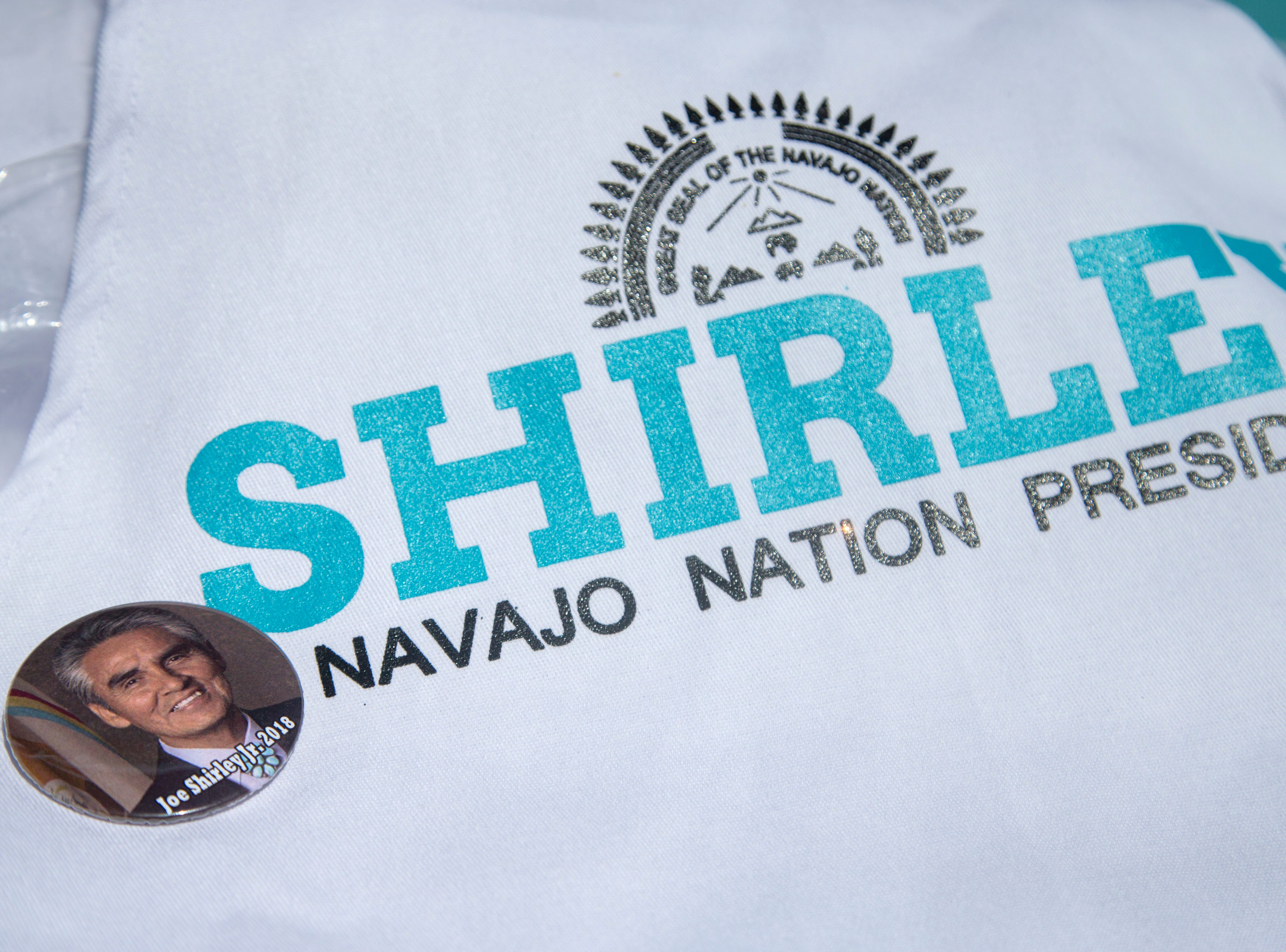 Campaign materials for former Navajo Nation president and current presidential candidate Joe Shirley Jr. sit on a table outside the Fort Defiance chapter house on Aug. 28, 2018 where chapter members cast their vote in the primary election in Fort Defiance.