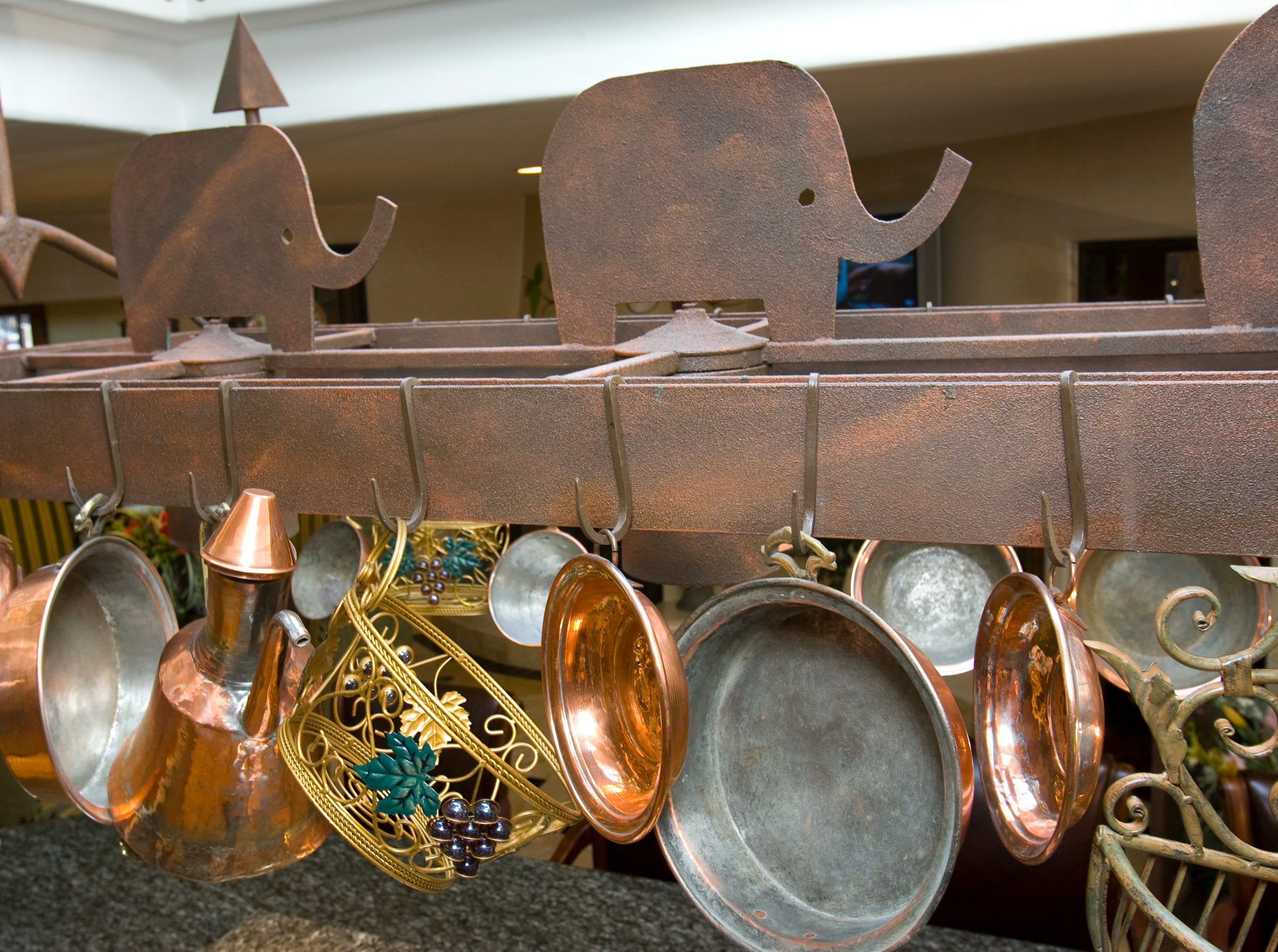 The kitchen island pot holder in the former home of Sen. John and Cindy McCain, seen here in 2008, still shows the GOP elephant symbols and ship anchors to commemorate John's military service.