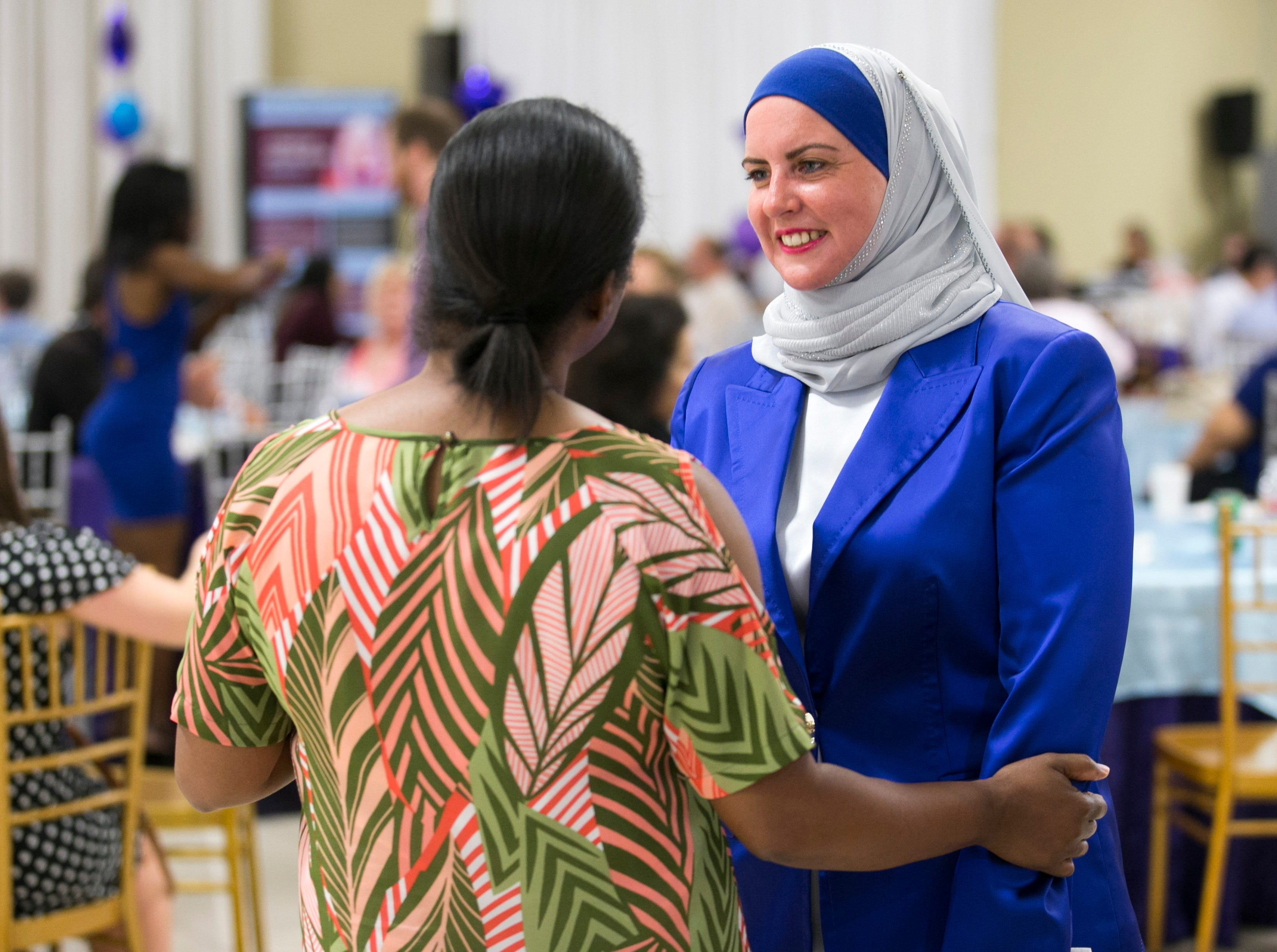 Deedra Abboud, who is vying for the Democratic nomination for the U.S. Senate seat, talks with a supporter at a watch party for the Arizona primary at Pearls Banquet Hall in Mesa on Tuesday evening, August 28, 2018.