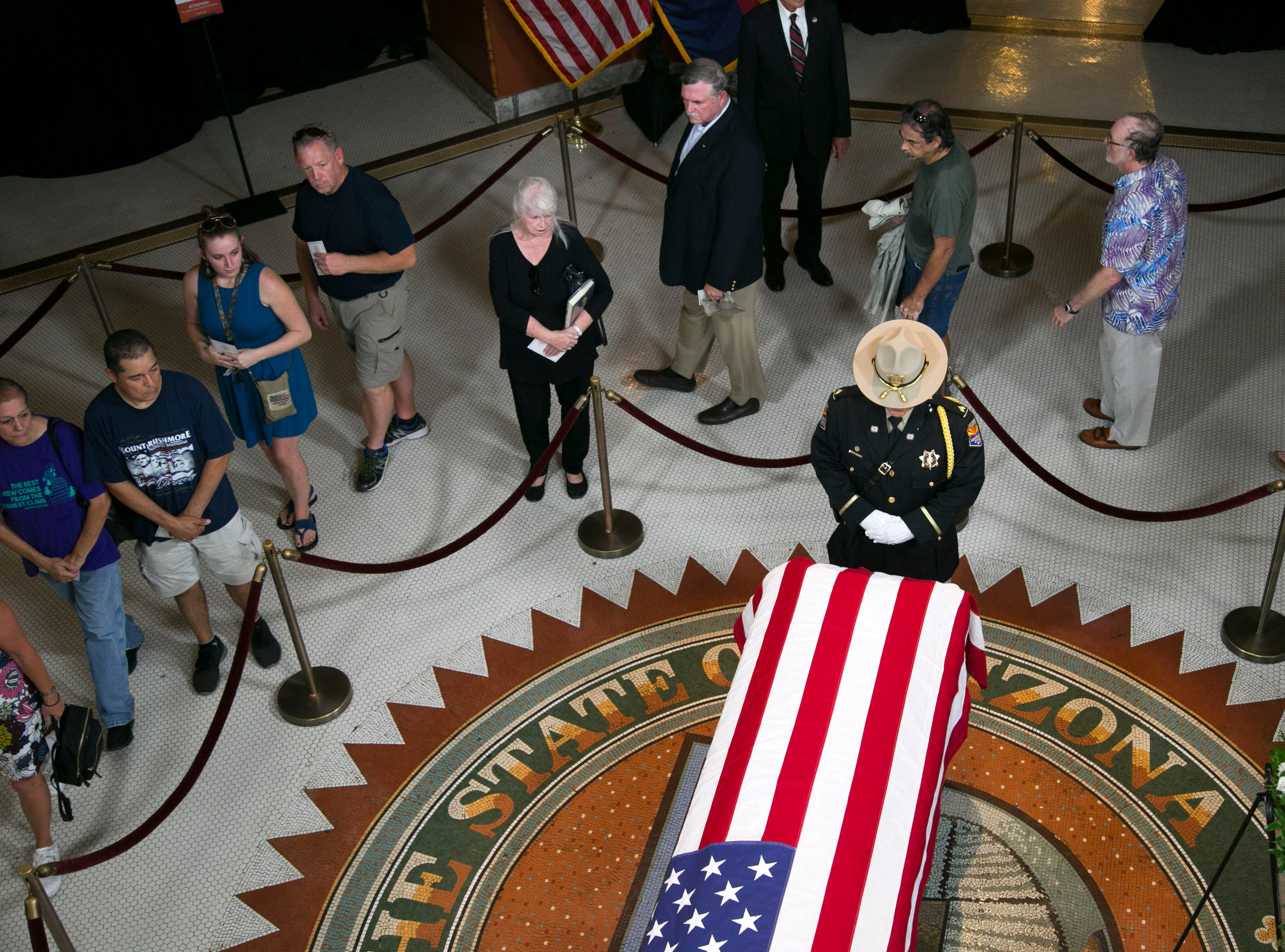 People pay their respects as Senator John McCain lies in state in the state capitol in Phoenix on Wednesday, August 29, 2018.