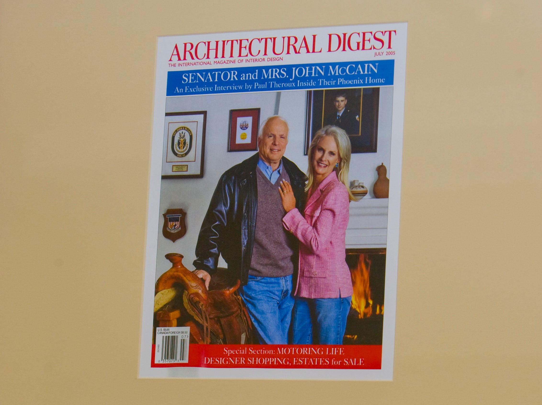 A magazine article featuring  the former home of  John and Cindy McCain is framed and seen in a backyard utility room in 2008.