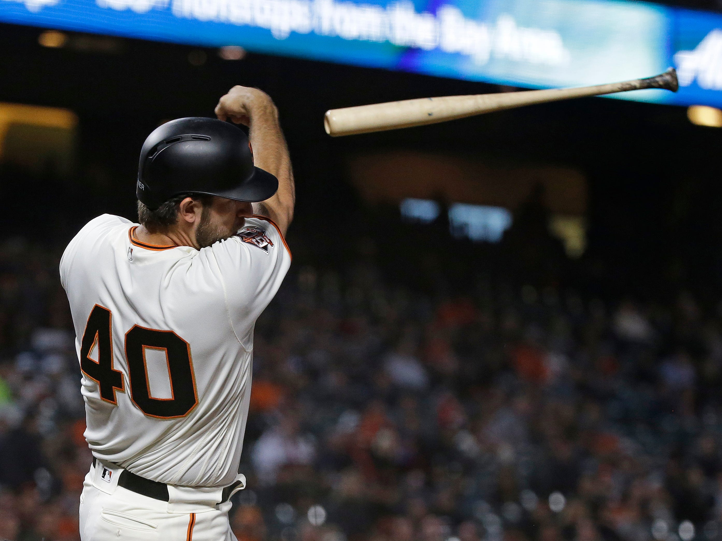 San Francisco Giants' Madison Bumgarner sends his bat flying while facing Arizona Diamondbacks starting pitcher Clay Buchholz in the third inning of a baseball game Tuesday, Aug. 28, 2018, in San Francisco.