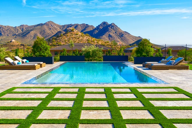 John and Sylvia Newell's wet-edge pool in Scottsdale's Boulder Mountain Estates features a linear layout that's centered for maximum impact.