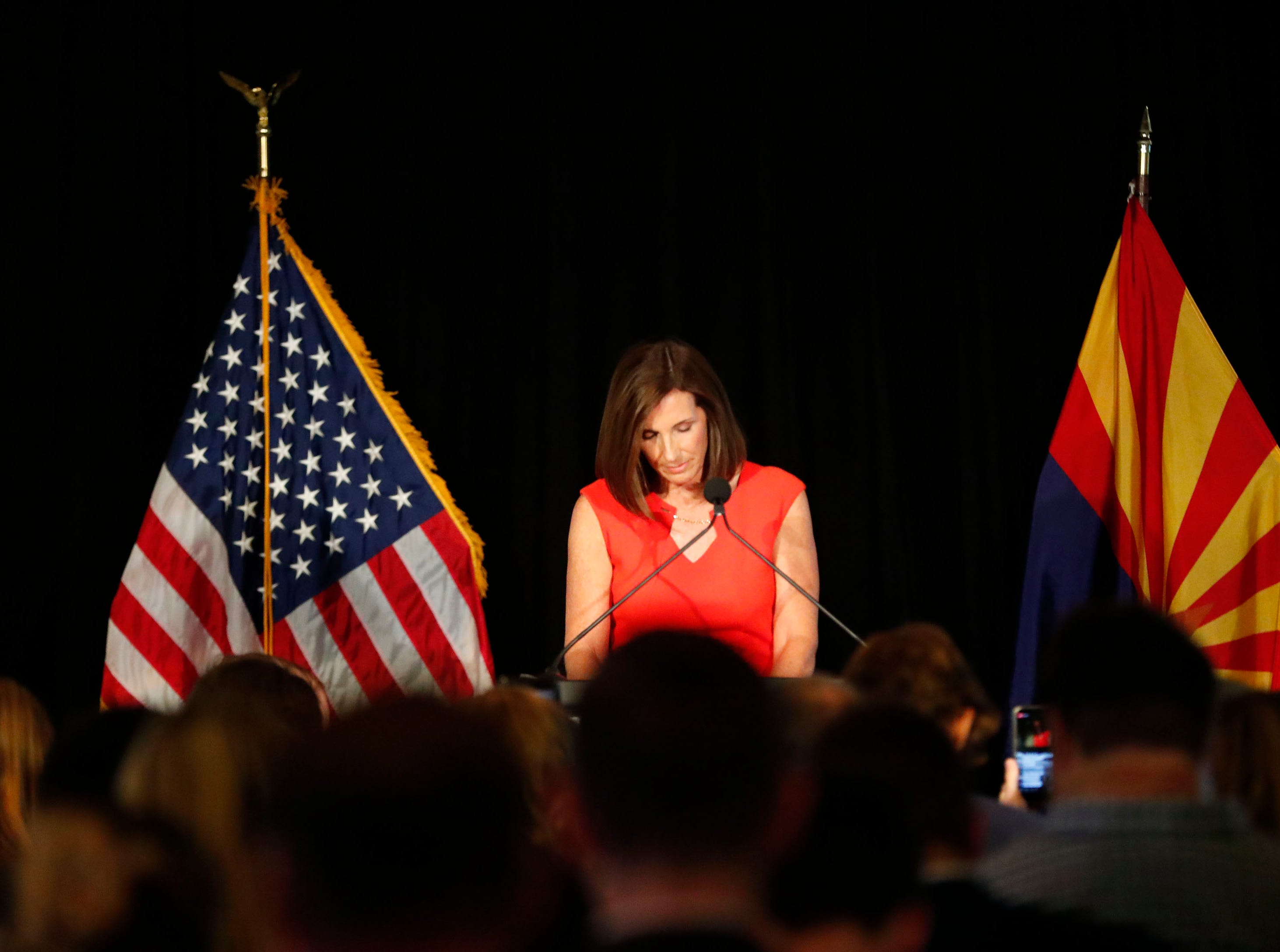 Rep. Martha McSally bows her head during a moment of silence for the late Sen. John McCain during a primary election party In Tempe, Ariz. August 28. 2018. McSally  The two-term congresswoman from Tucson is vying for the Republican nomination for the open U.S. Senate seat.