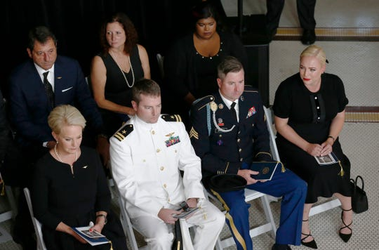 Cindy McCain sits with sons Jack and Jimmy and daughter Meghan during a memorial service for Sen. John McCain at the Arizona Capitol on Aug. 29, 2018. Behind her (from left) are Doug and Sidney, who are John McCain's children from his first marriage, as well as John and Cindy's daughter Bridget.