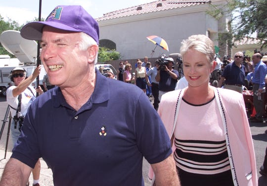 Sen. John McCain and his wife, Cindy McCain, meet with reporters gathered in front of their Phoenix home in 2000.