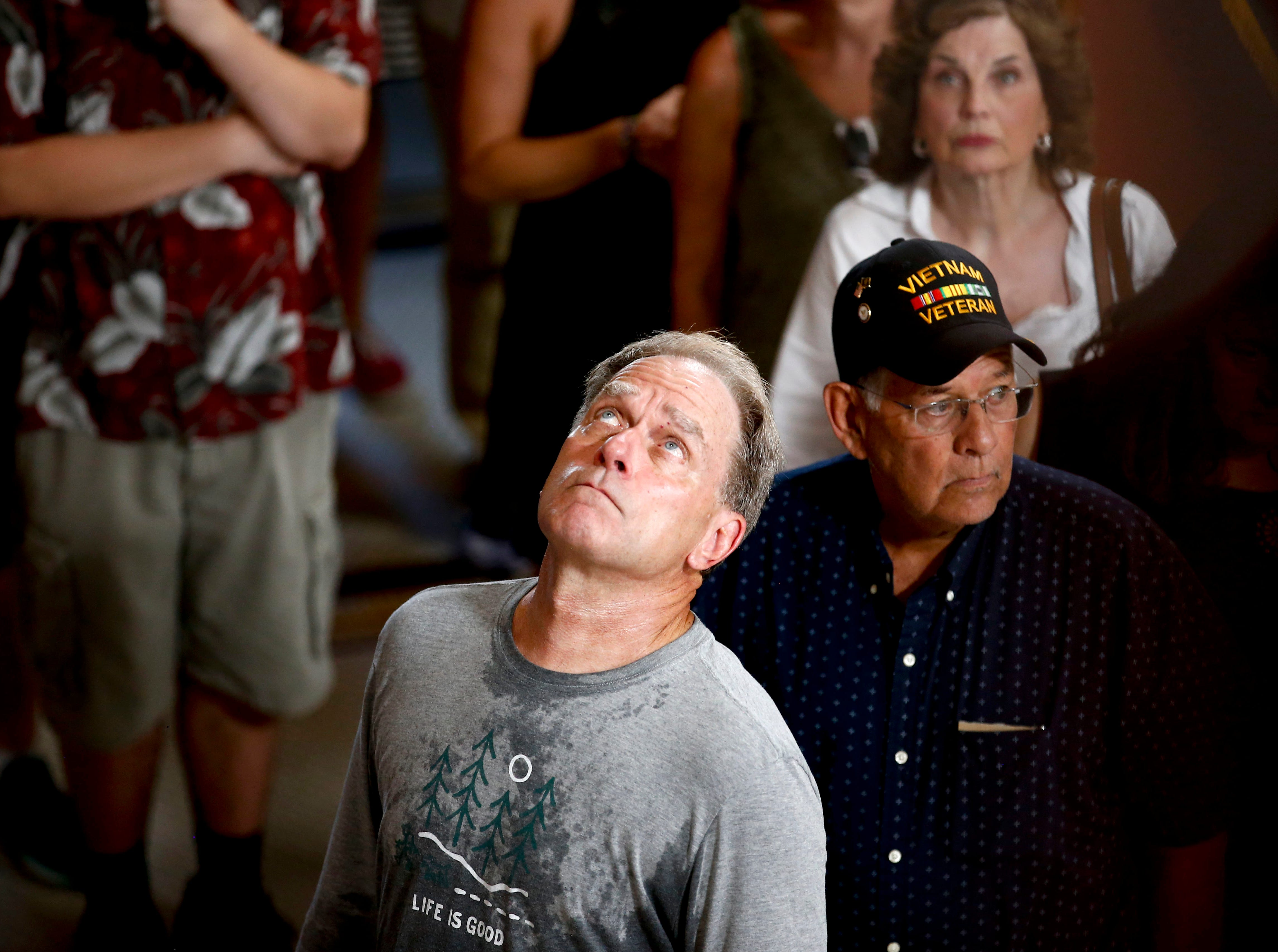 Members of the public pay their respects near the casket of Sen. John McCain during a viewing at the Arizona Capitol on Wednesday, Aug. 29, 2018, in Phoenix. (AP Photo/Ross D. Franklin)