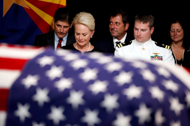 Cindy McCain, wife of Sen. John McCain, R-Ariz., sits with her son Jack during a memorial service at the Arizona Capitol on Aug. 29, 2018, in Phoenix.