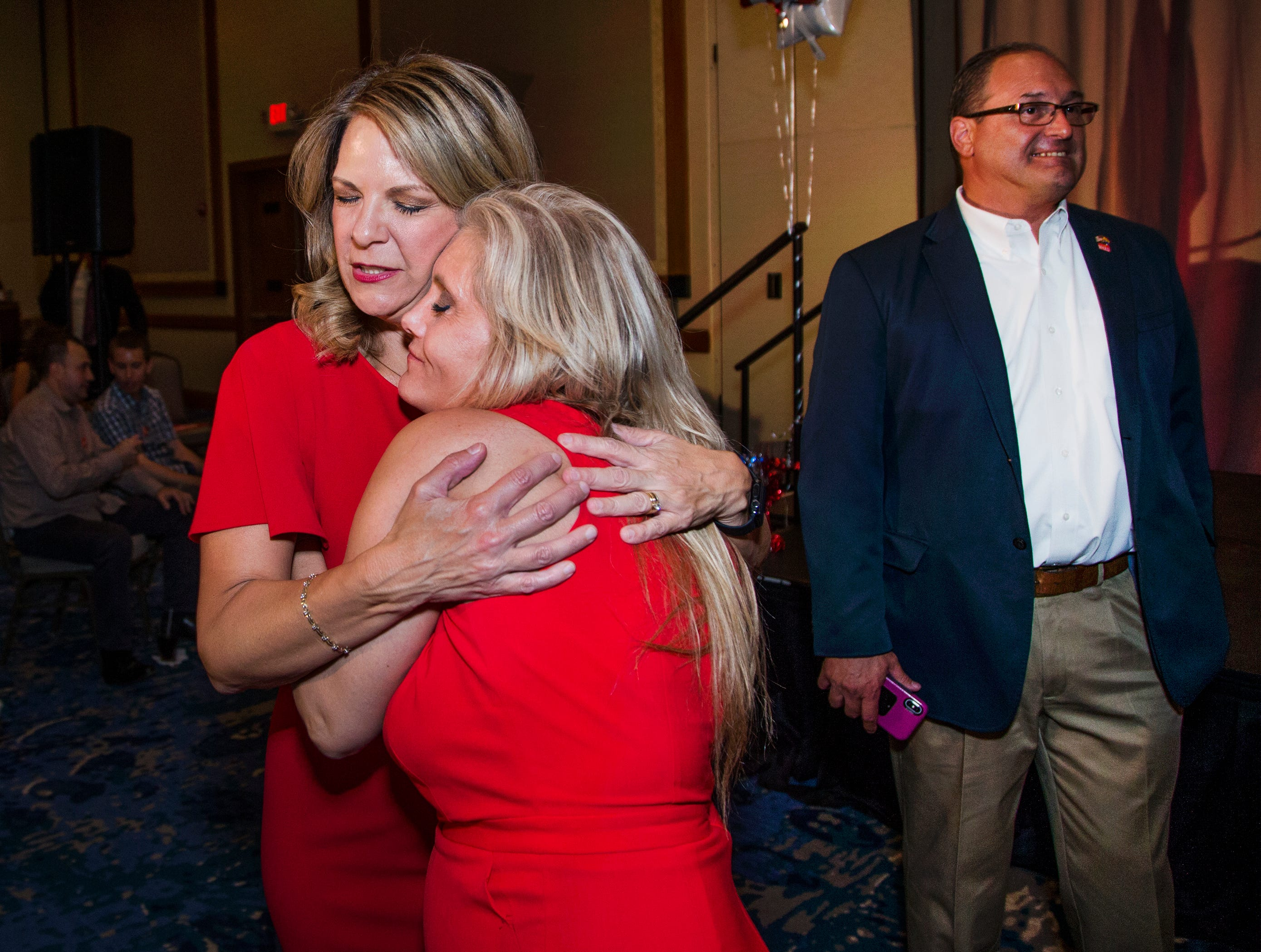 Kelli Ward (left) hugs supporter Suzette Meyers during a primary election night party at Embassy Suites Scottsdale on Aug. 28, 2018. Ward's husband, Michael, is at right.