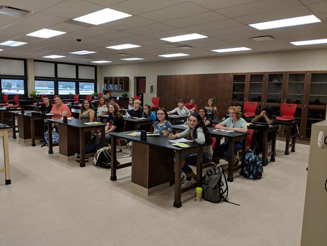 Members of the Port Clinton High School Class of 2022 get ready for their first day of high school in Mrs. Meisler's newly renovated Science Classroom.