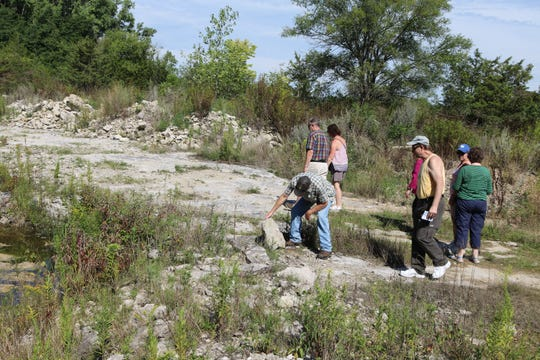 Local islanders and visitors check out the Curilla Preserve, a new 15-acre public passive park at Kelleys Island.