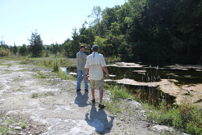 Andy McDowell, left, of the Western Reserve Land Conservancy, and Pat Hayes of Kelleys Island walk along the new Curilla Preserve.