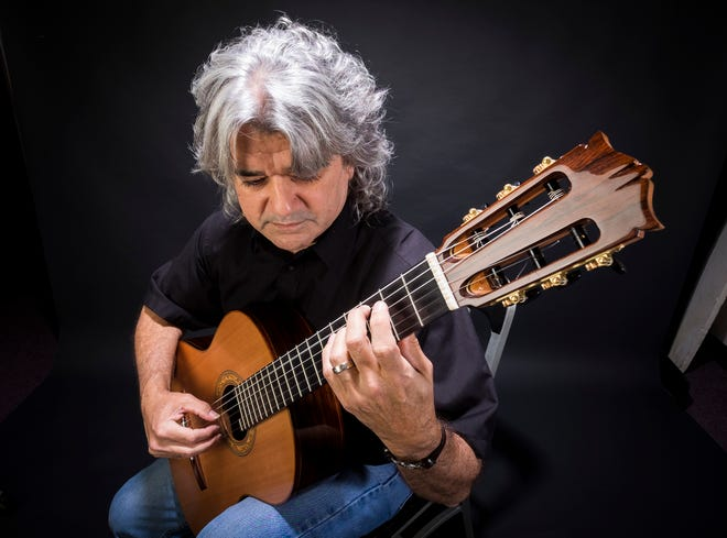 Guitarist Bill Russell plays his nylon string guitar Wednesday, Aug. 29, 2018. Russell, who won the Indiana State Fingerstyle Guitar Championship in July, will be performing at Thumbfest in Lexington Saturday.