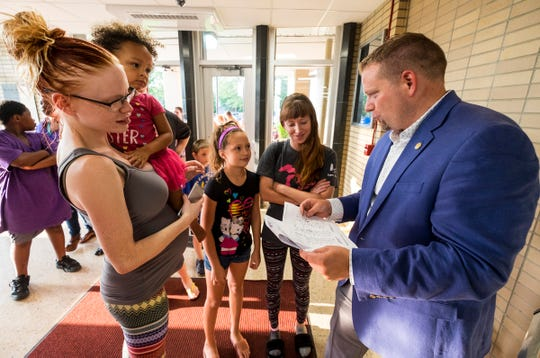 STEAM Academy at Woodrow Wilson principal Joe Kramer, right, helps students find their class assignments Tuesday, Aug. 28, 2018, during an open house at the school.