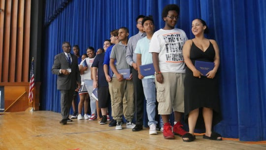 Some of the teens who completed their graduation requirements over the summer and earned a Poughkeepsie High School diploma in August attended a celebration in their honor on Aug. 29, 2018. To the left is acting high school Principal Ronald Jackson.