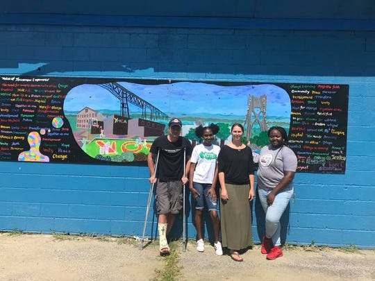 City of Poughkeepsie Councilman Chris Petsas, Voice of Tomorrow Empowered participant Rifain Thigpen, program coordinator Julie Okoniewski and program staff member Amena Ruffin pose with the mural at Pulaski Park.