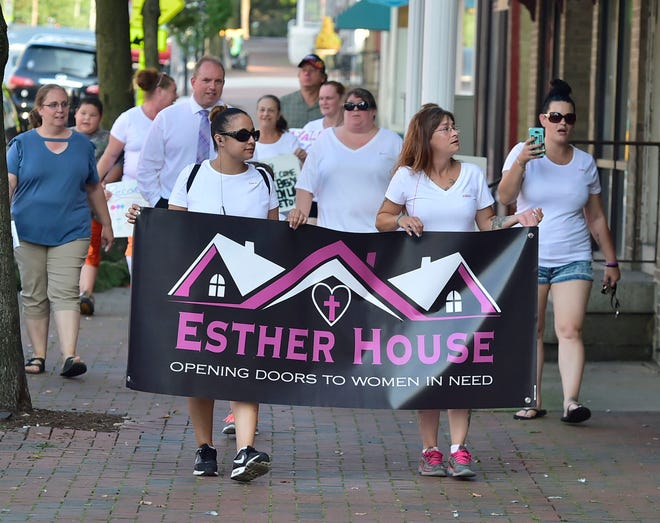 A group walks along East Main Street in Waynesboro. Esther House held a Recovery Awareness Walk in Waynesboro, Tuesday, August 28, 2018 as a group of supporters and other family walked along Main Street, Waynesboro.