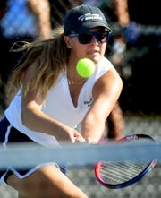 West York's Audrey Kinney returns at the net against York Catholic's Annie Stitch in their top-seeded match at Springettsbury Township Park Wednesday, August 29, 2018. Bill Kalina photo