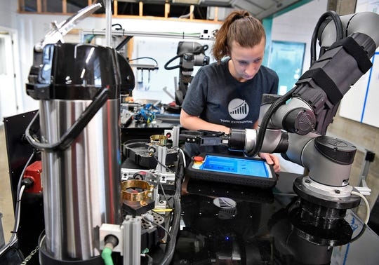 Danielle Schultz programs a York Exponential Cobot that serves coffee, Wednesday, August 21, 2018.  John A. Pavoncello photo