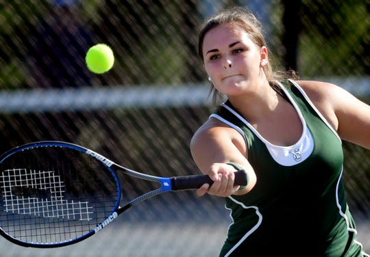 York Catholic's Clare Brennan  returns a backhand against West York's Alisa Steele in their second-seeded match at Springettsbury Township Park Wednesday, August 29, 2018. Bill Kalina photo