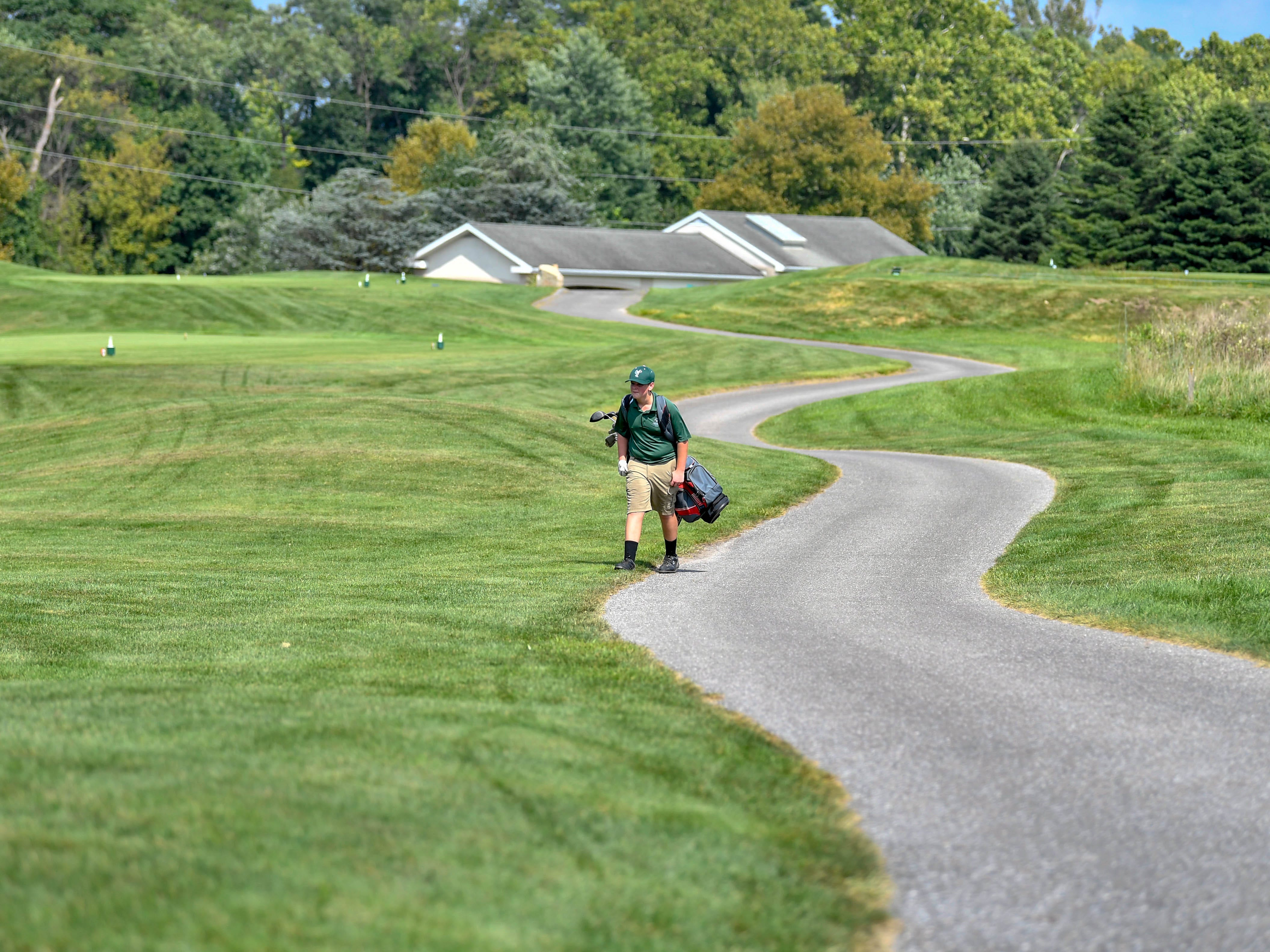 Dylan Lawler of York Tech heads to the next hole at Regents Glen Country Club, Tuesday, August 28, 2018.
