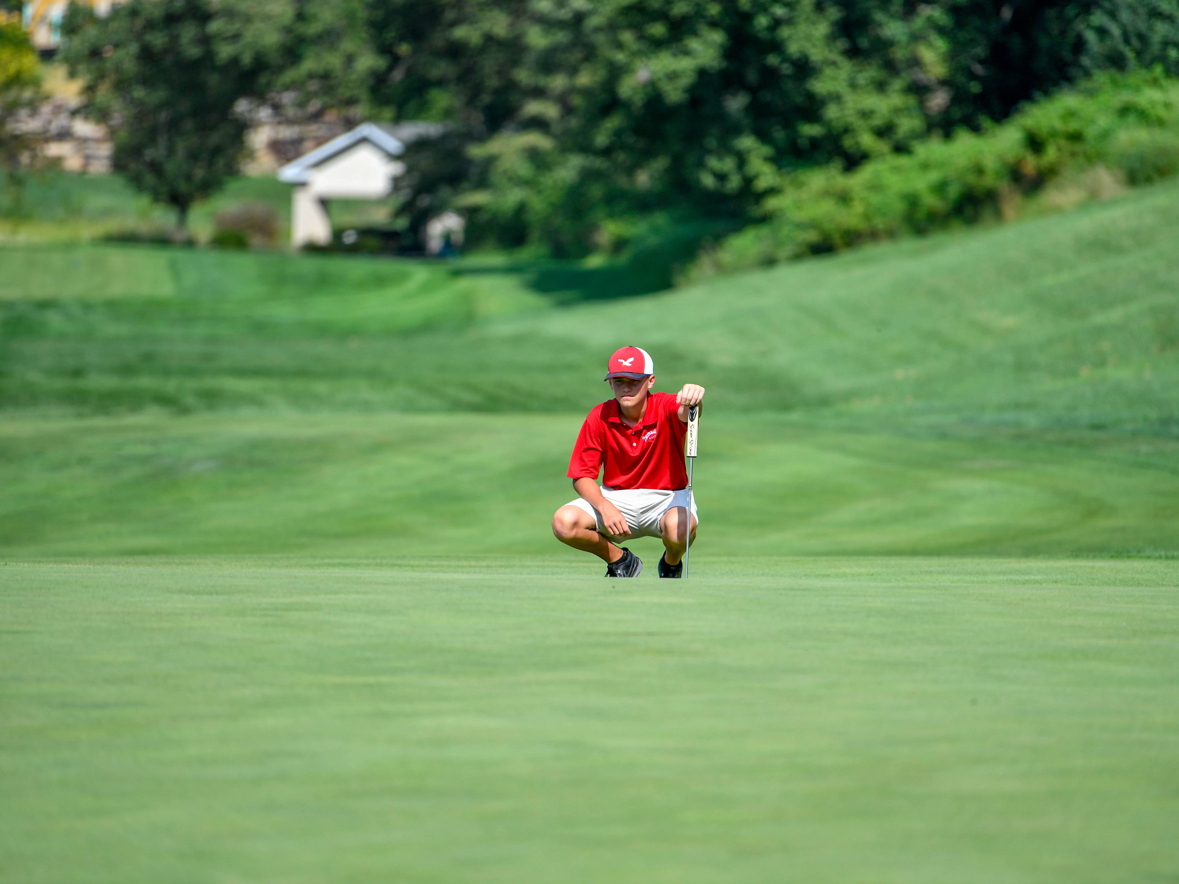 Tucker Byers of Bermudian Springs looks at the long putt ahead at Regents Glen Country Club on August 28.