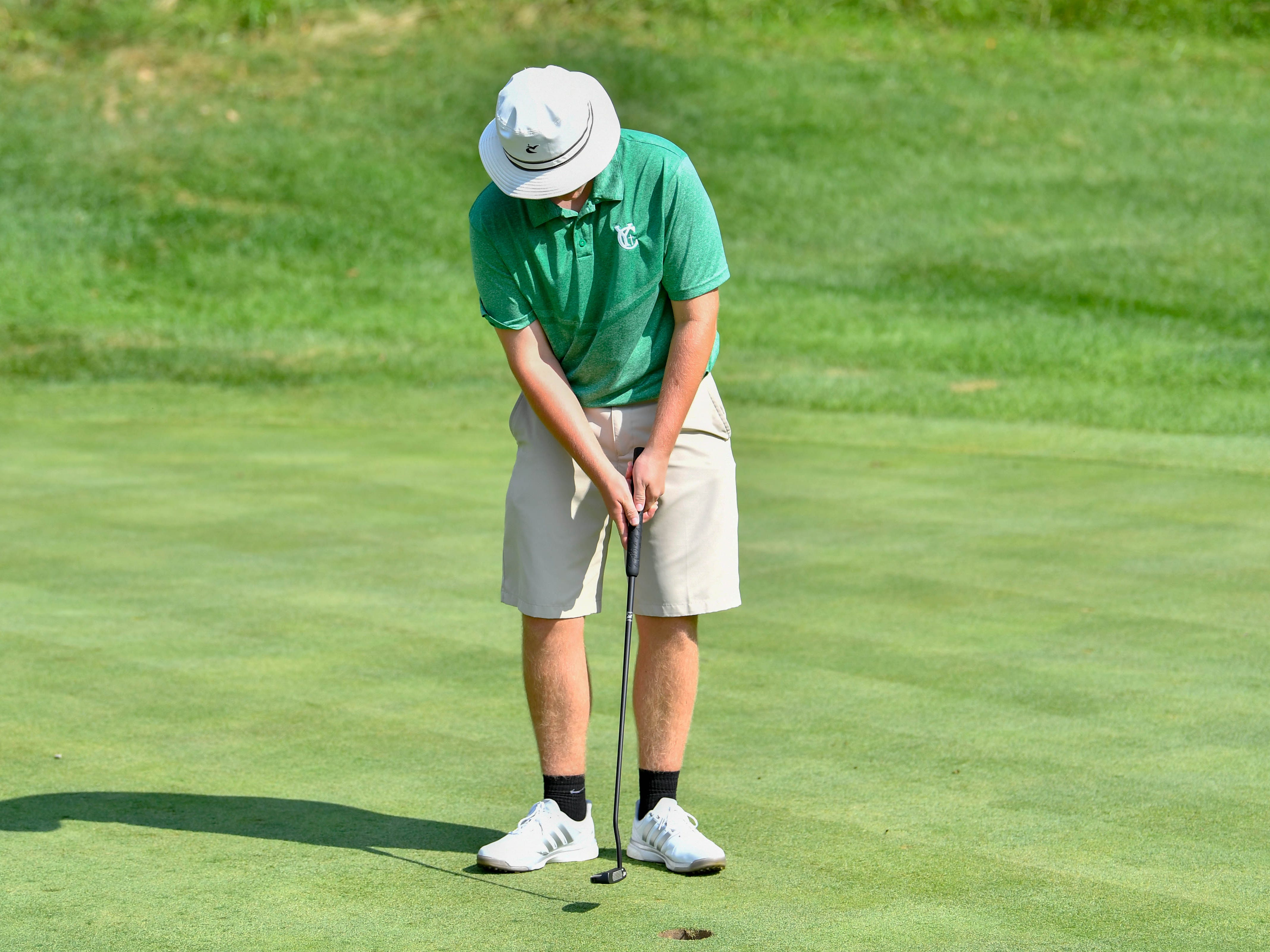 Russ McPaul of York Catholic High School sinks the short putt during the YAIAA Division III golf match on August 28, 2018.