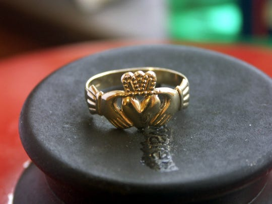 On the ring, the two hands represent friendship, the heart represents love and the crown represents loyalty.