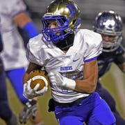 Reed's George Moreno carries the ball against Damonte last season