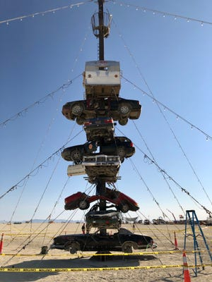 """Safety rangers have closed Nevada-based artist Dustin Weatherford's """"Night at the Climb In"""" sculpture after someone fell off it late Tuesday or early Wednesday. Safety tape surrounds the installation on Wednesday, and rangers were barring people from climbing it."""