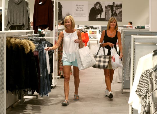 Jennifer Yodice of Hilton, left, and sister Amy Wegman of Greece say items at H&M are well-priced.