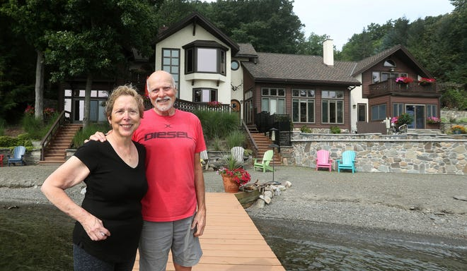 Jim and Gail Felli have lived since 1992 at their 5,300-square-foot house on Seneca Lake, which is on the market for $2.45 million.