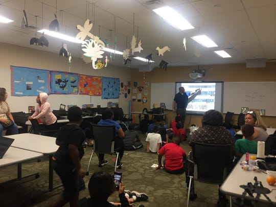 This is a classroom at Horizons at Warner during a meet the author day.