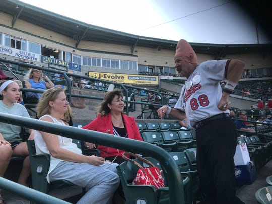 """Tom """"Conehead'' Girot vists with Red Wings CEO Naomi Silver, middle, and Jennifer Skinner, wife of manager Joel Skinner  at Frontier Field. """"He's like another mascot,'' Silver said of famed beer vendor."""