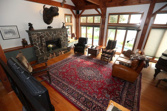 The post and beam construction in the chalet-style home is evident in the living room.