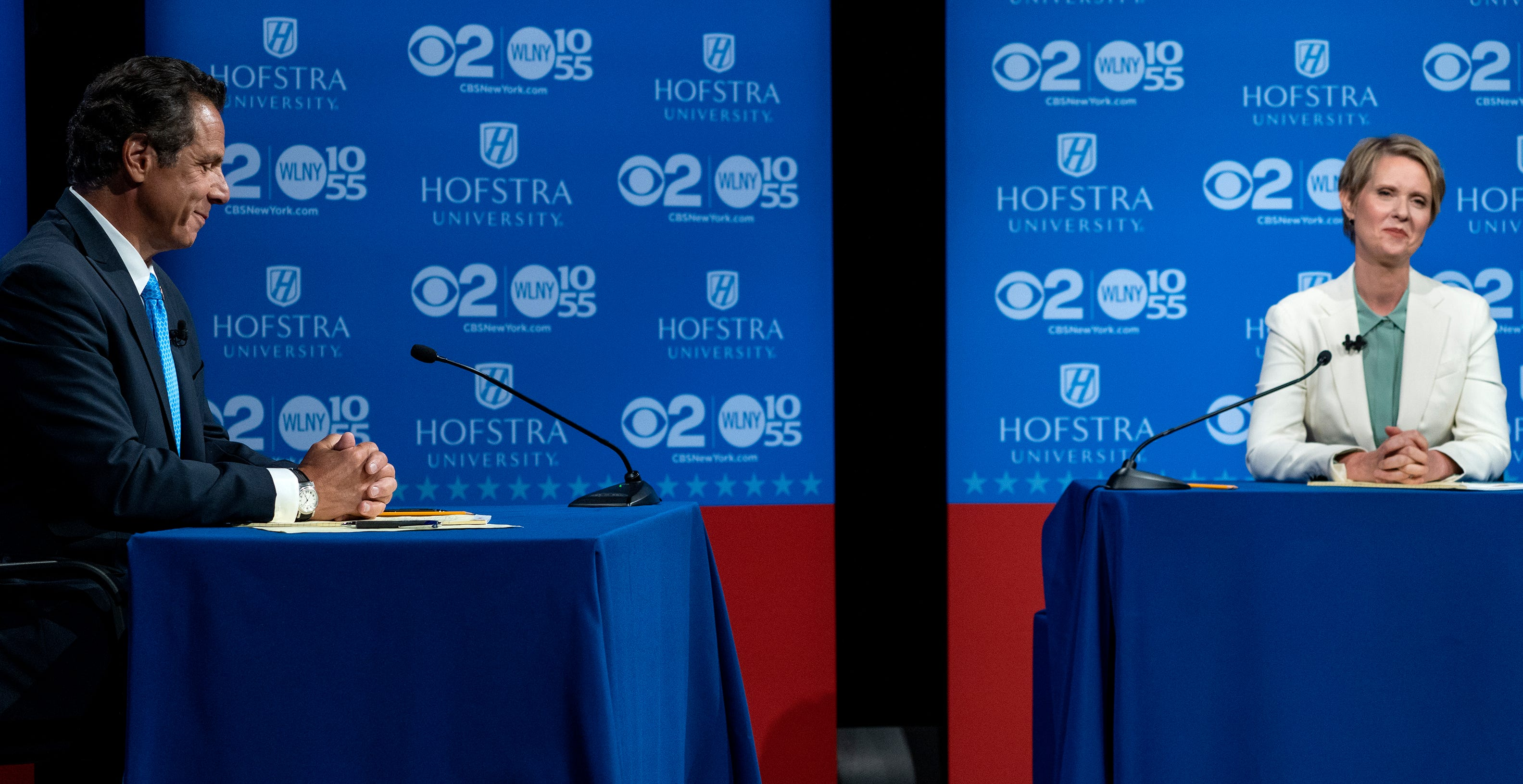 New York Gov. Andrew Cuomo and Democratic New York gubernatorial candidate Cynthia Nixon pause before the start of a gubernatorial debate at Hofstra University back in August.