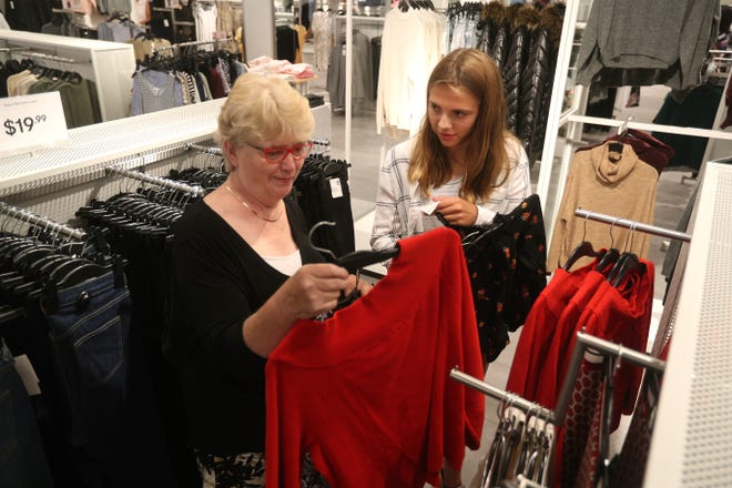 Trudy Hicks and her granddaughter Iris Boerman, 14, shopping at H&M in the Waterloo Premium Outlets.