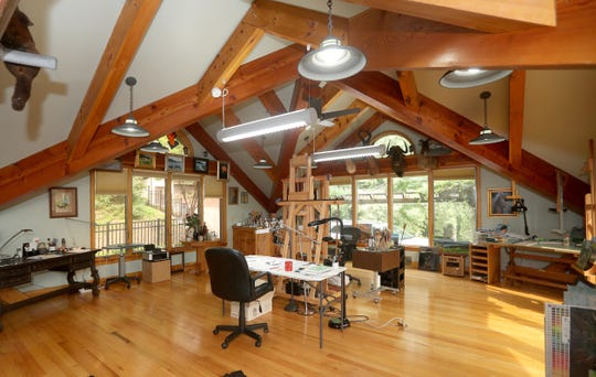 A artist studio on the second floor is where Jim Felli paints landscapes and portraits as a hobby.