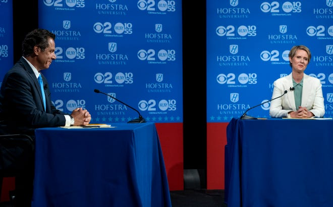New York Gov. Andrew Cuomo and Democratic New York gubernatorial candidate Cynthia Nixon pause before the start of a gubernatorial debate at Hofstra University in Hempstead, N.Y., Wednesday, Aug. 29, 2018.